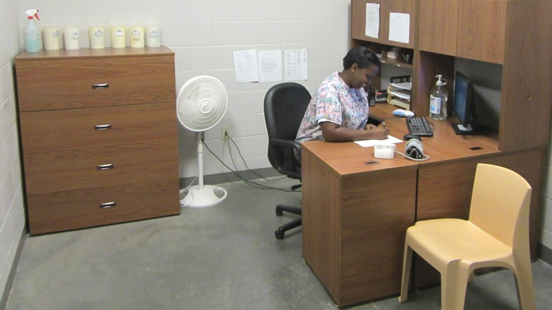 Medical employee sitting her desk